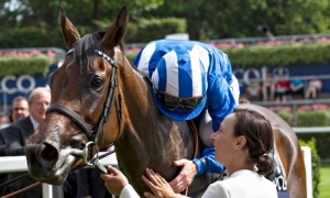 Paul Hanagan after Taghrooda wins the King George VI and Queen Elizabeth Stakes at Ascot