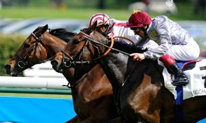 Christophe Soumillon riding Cirrus Des Aigles wins the Prix Ganay from Treve and Frankie Dettori
